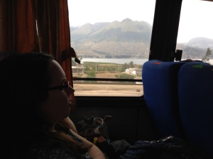 Catching a snooze on the bus with volcanoes and lakes in the background.