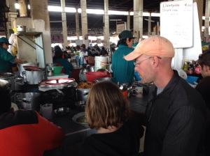 My husband and daughter enjoying a $1.33 lunch special, including drink, at the mercado.