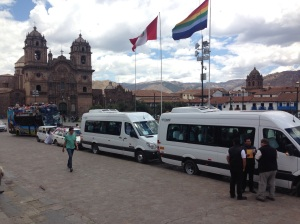 A typical day in the main plaza with tourists, tour buses and vendors.