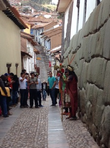 This man dresses like an Incan Emperor and stands in this alley every day.
